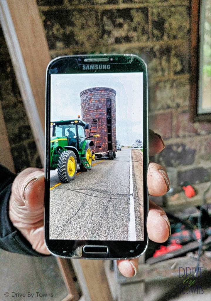 Moving a silo with a tractor