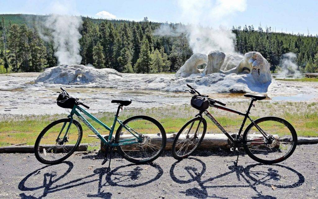 Our Schwinn bikes stylin' and profilin' in front of Grotto Geyser in Yellowstone National Park