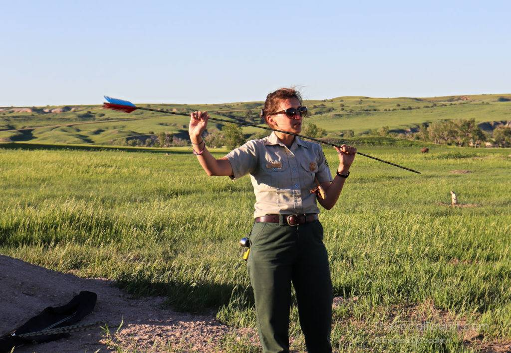 Park Ranger demonstrating how to use an atlatl at Badlands National Park