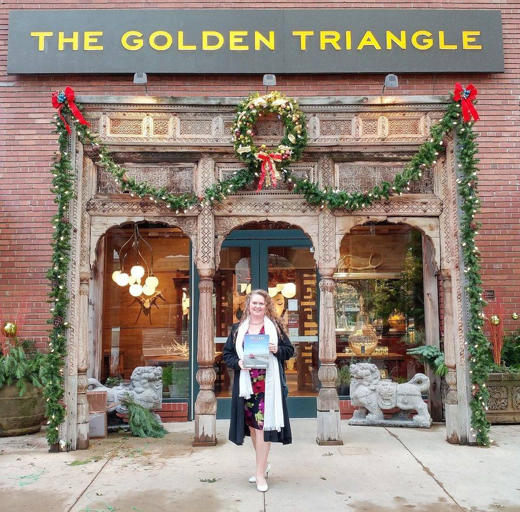 Theresa L. Goodrich at her book launch party for Two Lane Gems, Vol. 1, in front of The Golden Triangle