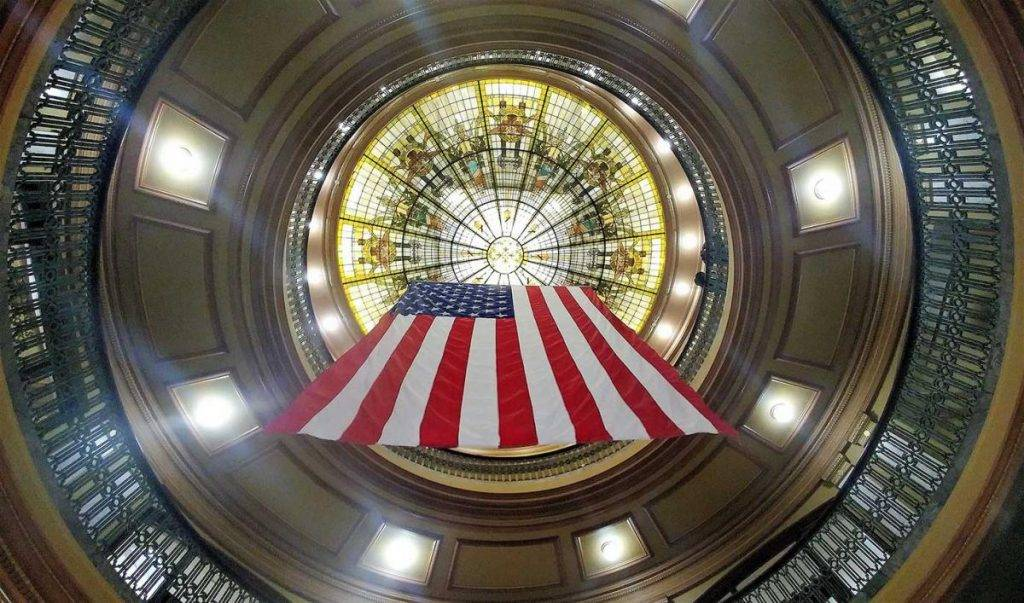 Flag hanging from the stained glass dome atop the Hendricks County Courthouse