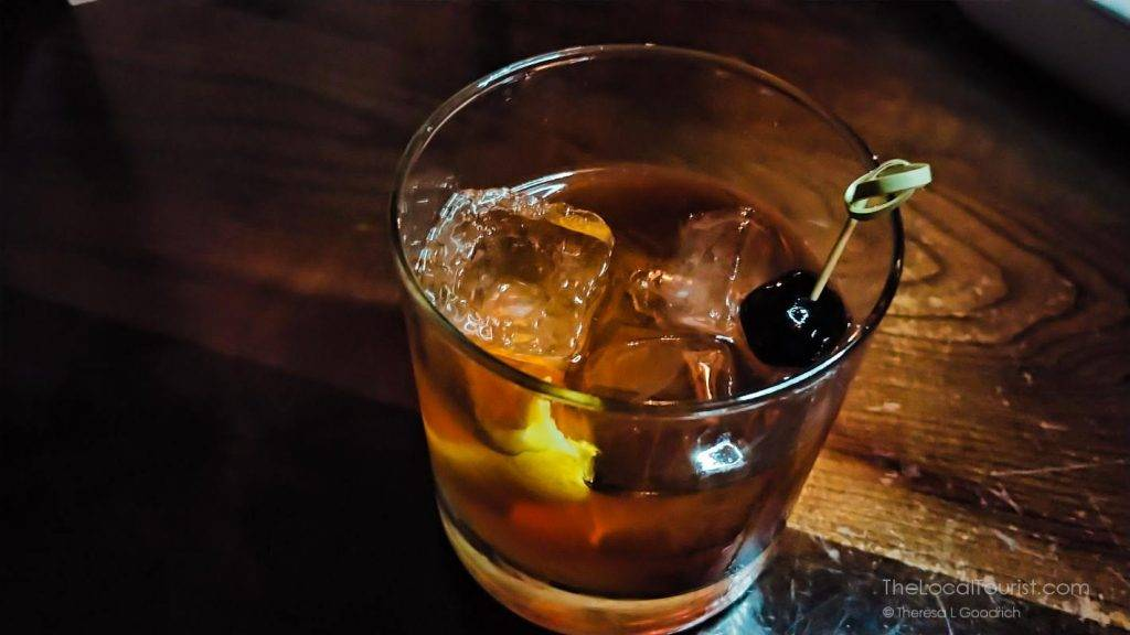 Laphroaig, Aperol, Lillet aperitif wine, Drambuie, and house-made lemon bitters at Clinton Street Social Club