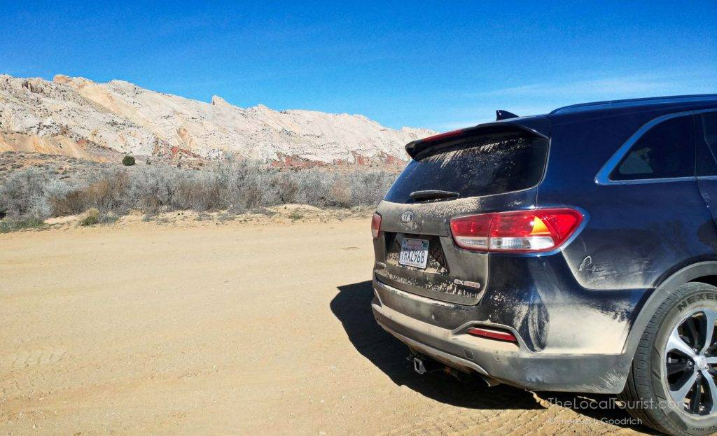Mae Sorento earned that dusty bumper after a drive down Burr Trail Road