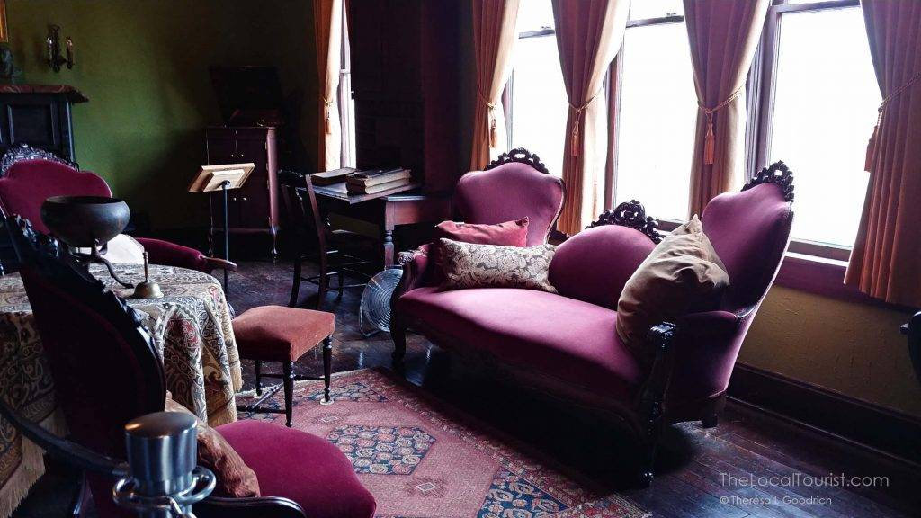 Victorian furniture and oriental rugs decorated the House of the Singing Winds
