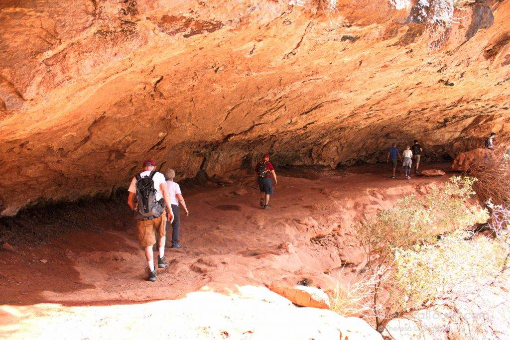 Walking under an overhang on the Canyon Overlook Trail in Zion National Park