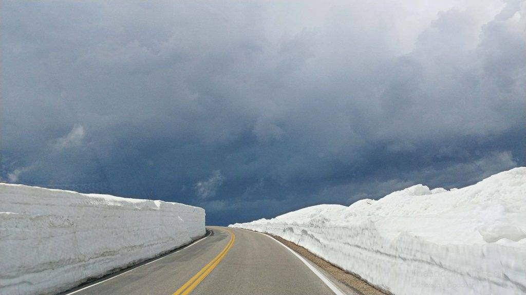 Driving through the snow-capped peaks of Beartooth Highway