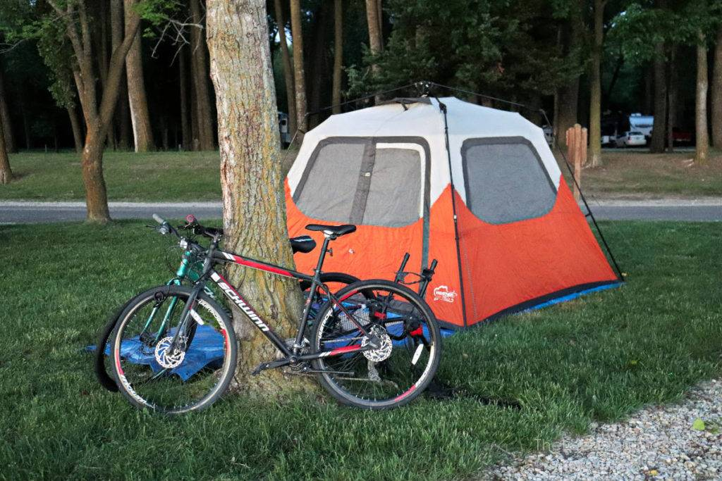 Campsite at Lewis & Clark State Park in Iowa with bikes locked to tree