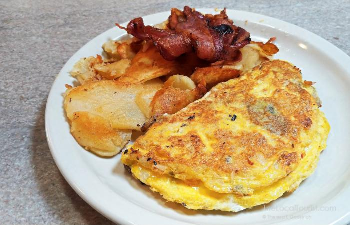 Omelette, American potatoes, and bacon at Franks Diner