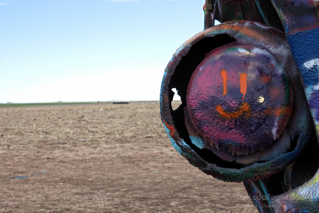 Happy face painted on the rear tire of a Cadillace