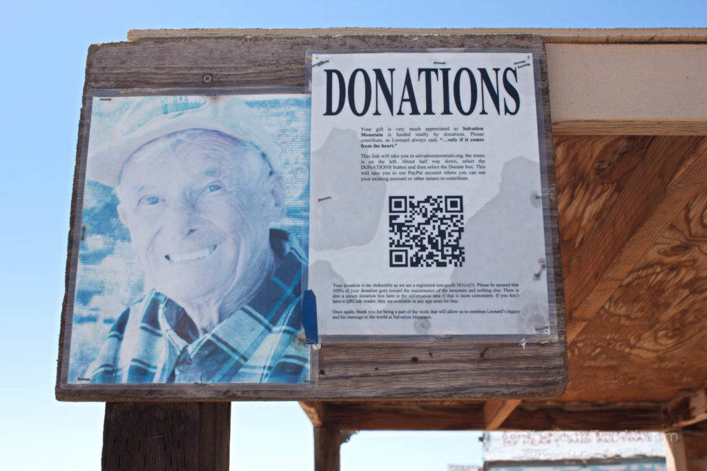 Donation request at Salvation Mountain with photo of Leonard Knight