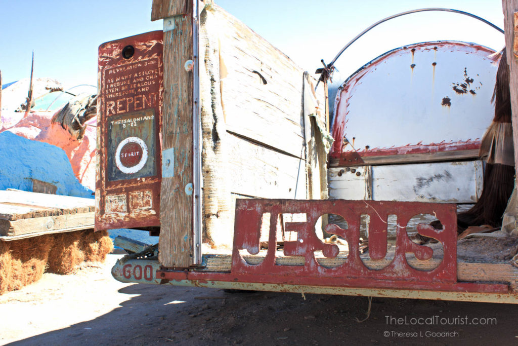 Metal stencil of JESUS on back of truck