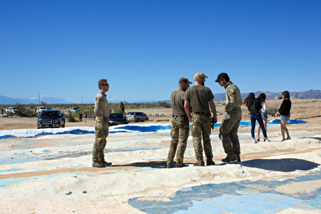 Men wearing camouflage at Salvation Mountain