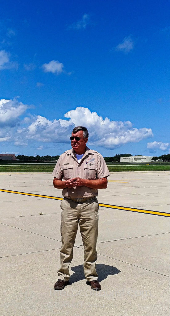 Pilot Kenneth Morris giving a debriefing before we board Aluminum Overcast