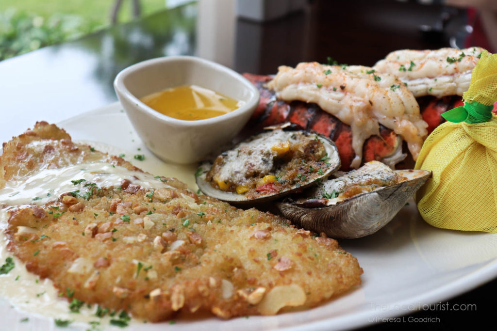 cold water lobster tail, savory clams casino with bacon, and delicate New England flounder coated in an almond crust with a champagne-shallot cream sauce at Grand Victoria Casino a restaurant in Elgin Illinois