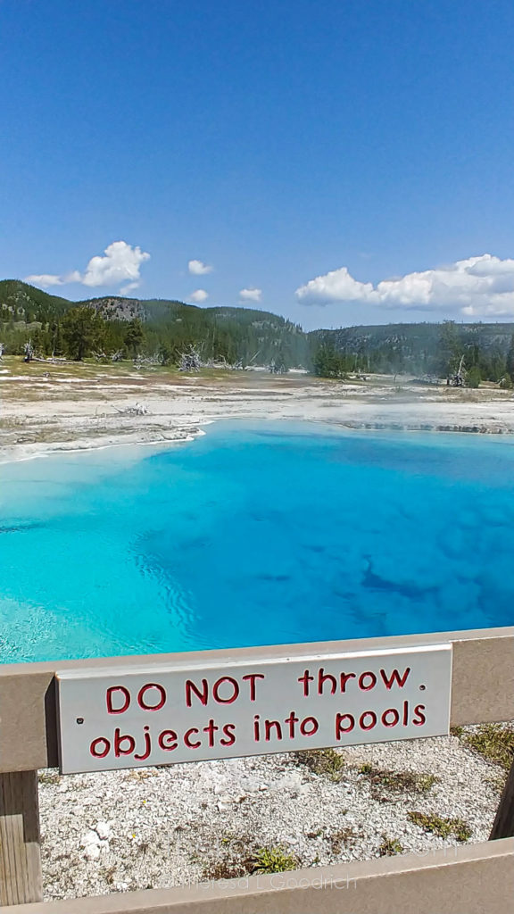 """Do not throw objects into pools"" sign near pool in Yellowstone"