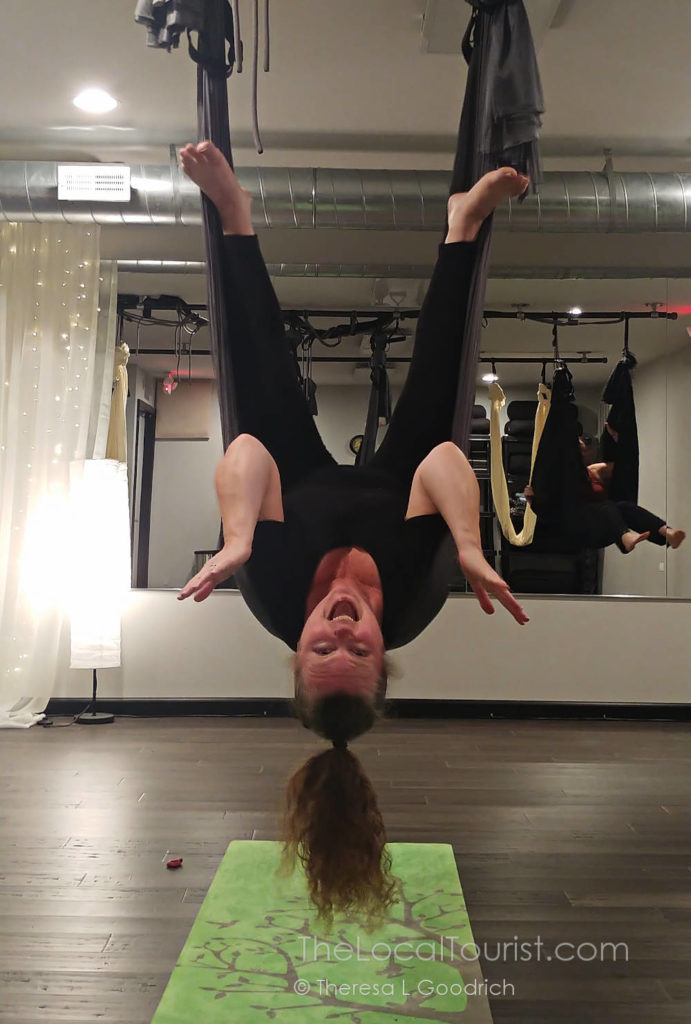 Theresa getting inverted at aerial yoga