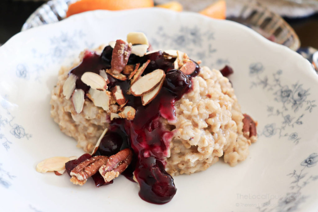 Oatmeal with blueberry compote and roasted slivered nuts