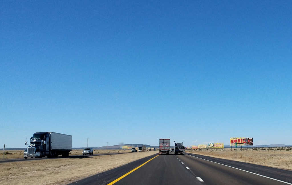 I-40 in New Mexico - a flat stretch of road with lots of billboards
