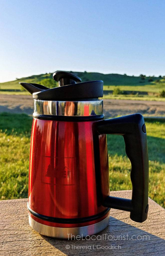 Skip the coffee shop and bring your own French press to save money on a road trip